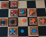 ILoS has 4 colored disks for 4 players.