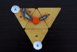 Figure 1b - Adding tile A gives orange token two more liberties; adding tile B gives the orange token one more liberty