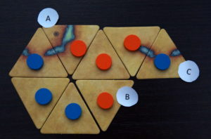 The blue player now claims the orange token group's one remaining liberty.